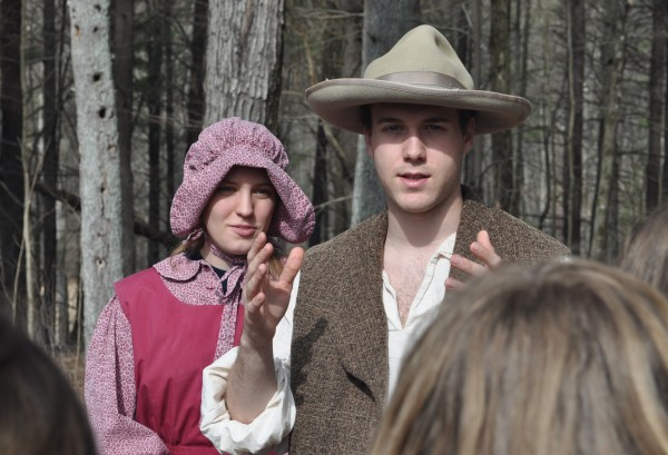 Tour guides in period apparel describe the maple sugaring process