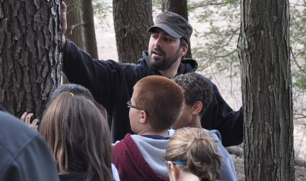 A Penn State student demonstrates tree identification
